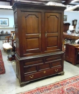 Oak Two Piece Clothes Cupboard with Double Panel Doors and Bracket Feet