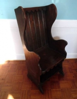 English Oak Lambing Chair with Winged Back and Shelf Under Seat